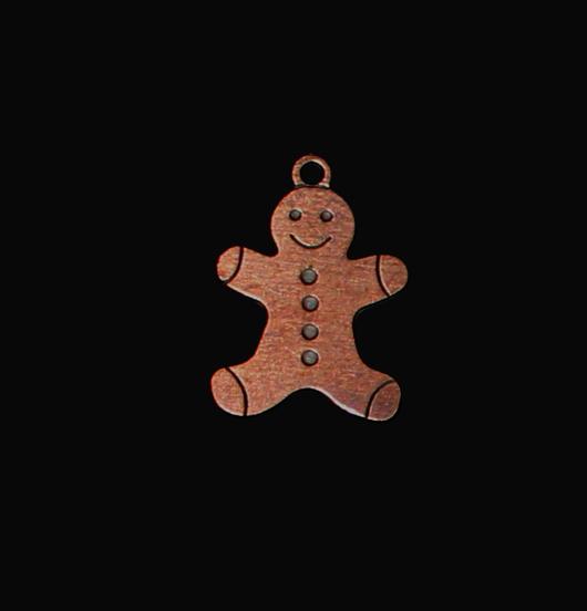 Ciondolo a forma di omino di Panpepato in rame per personalizzare i regali di natale. Regalo dedicato a chi ama i biscotti.